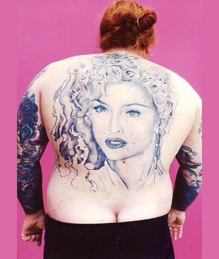 Madonna tattoo on back