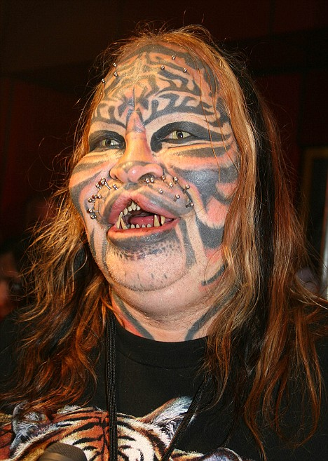 feline face man tattoo