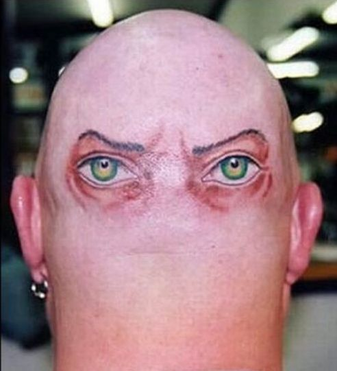 eyes behind head tattoo