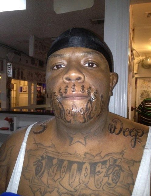 greedy money mouth tattoo
