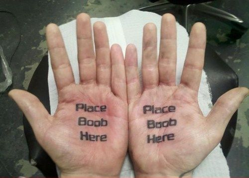 place boob here hand tattoo