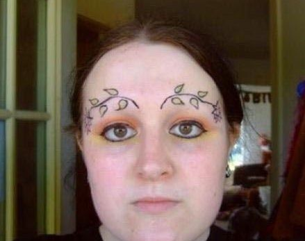 face leaf tattoo