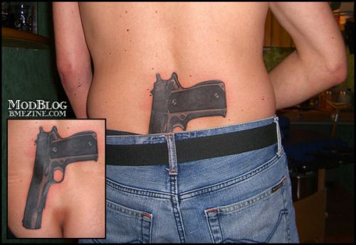 gun behind back tattoo