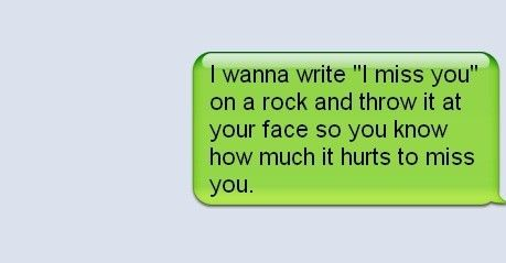 writing I miss you on a rock