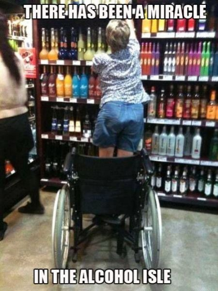 standing up in a wheelchair in the alcohol isle