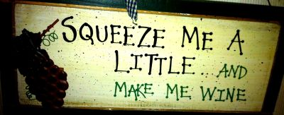 Squeeze me a little and make me wine sign
