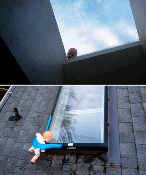 Toy baby behind window prank