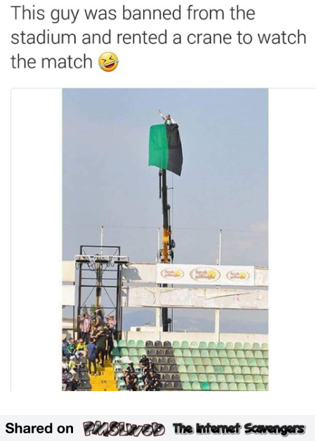 Guy rents crane to watch football match funny meme @PMSLweb.com